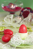 Easter table setting in green and red stock photo