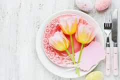 Easter table setting with holiday decor colorful eggs tulip blan Royalty Free Stock Photo
