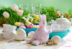 Easter table setting, home holiday decor concept, front view. Easter table setting, home holiday tableware decor concept, front view Royalty Free Stock Photos