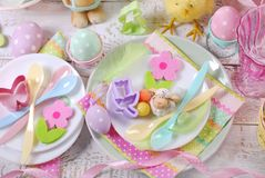 Easter table setting for kids in pastel colors Royalty Free Stock Images