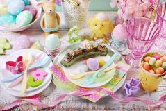 Easter table setting for kids in pastel colors Stock Photography