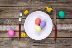 Easter table setting on old wooden table. Royalty Free Stock Image