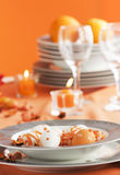 Easter table setting in orange tones Stock Photography