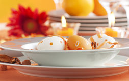 Easter table setting in orange tones royalty free stock photography