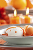 Easter table setting in orange tones royalty free stock images