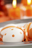 Easter table setting in orange tones stock images