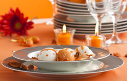 Easter table setting in orange tones Stock Photos
