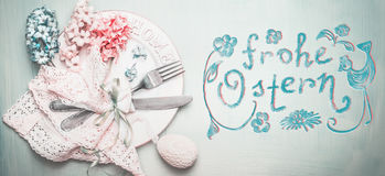 Easter table setting in pastel color with Frohe Ostern text in german Royalty Free Stock Photos
