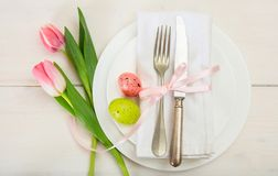 Easter table setting with pink tulips on white wooden background Royalty Free Stock Photography