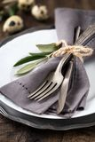 Easter table setting with plate and silverware stock image