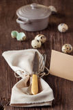 Easter table setting with quail eggs Stock Photos