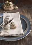 Easter table setting with quail eggs and cutlery Royalty Free Stock Photography