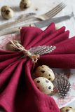 Easter table setting with quail eggs. And feathers Royalty Free Stock Images