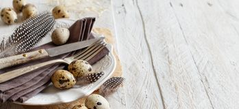 Easter table setting with quail eggs. And feathers Stock Photography