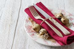 Easter table setting with quail eggs. And feathers Royalty Free Stock Photo