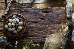 Easter table setting.Quail eggs in nest. Spring table stock photo