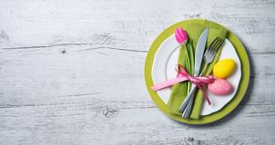 Easter table setting with spring flowers and cutlery Stock Photos