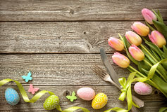 Easter table setting with spring tulips and cutlery Royalty Free Stock Photography