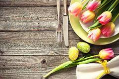 Easter table setting with spring tulips and cutlery Royalty Free Stock Photo