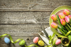 Easter table setting with spring tulips and cutlery Stock Photos