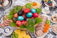 Easter table setting traditional food. Hand painted easter eggs on a festive table Stock Images
