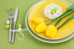 Easter Table Setting with Tulips and Eggs Stock Photo