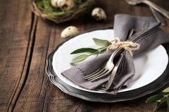 Easter table setting with plate and silverware stock images