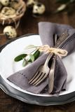 Easter table setting with plate and silverware stock photography