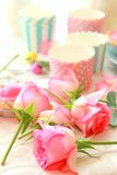 Easter table with sweet eggs, pink roses and fresh cakes Stock Images
