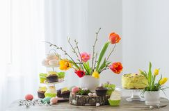 Easter table with tulips and decorations. Easter table with beautiful tulips and decorations royalty free stock images