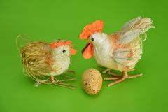 Easter tap and hen on green background. Easter Holidays and Traditions. Easter tap and hen on green background stock image