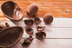 Easter tasty chocolate egg. On a wooden table. holiday candy dessert Royalty Free Stock Photography