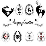 Easter template set with easter eggs hand drawn letters and leaves, black on white background. Decorative elements collection with. Folk art eggs.  vector royalty free illustration