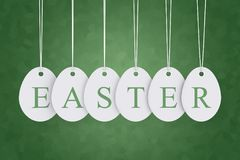 Easter text on egg shape hanging labels Royalty Free Stock Images