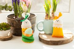 Easter textile basket. Easter decorations - textile rabbit with egg and flowers Royalty Free Stock Image