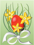 Easter theme with red egg and daffodils Royalty Free Stock Images