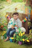A boy and a rabbit with chickens Royalty Free Stock Photo