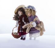 Easter theme tableau. Two vintage dolls with easter eggs and bunny holding hands Stock Photo
