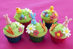 Easter themed cupcakes. Easter cupcakes with bunnies, chicks, eggs, flowers and carrots made from icing sugar Royalty Free Stock Photos