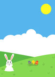 Easter themed nature background with bunny and colorful eggs Stock Photo