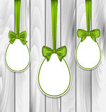 Easter three papers eggs wrapping green bows Royalty Free Stock Photos