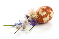Easter time. Hand painted easter egg and spring flowers composition stock image