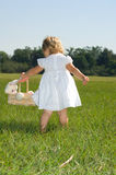 Easter Time. Little girl with bunny rabbit easter basket Royalty Free Stock Images