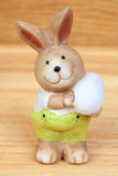 Easter time. Ceramic rabbit with a egg Royalty Free Stock Images