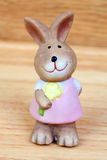 Easter time. Ceramic rabbit with a flower Stock Photography