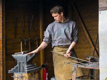 A  young blacksmith demonstrating his skills on street in Prague in the Czech republic. At Easter time in Prague markets, demonstrations and stalls spring up in royalty free stock photography