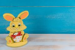 Easter bunny on blue background royalty free stock images