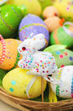 Easter toy bunny with colored eggs Royalty Free Stock Photography