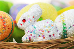 Easter toy bunny with colored eggs Stock Photo