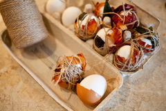 Easter tradition - boiled natural colored white and brown eggs with onions. On marble table Royalty Free Stock Photography
